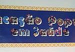 Parte do cartaz, escrito educaçao popular em saúde
