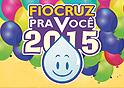 Logo do Fiocruz pra você 2015, com fundo com balões coloridos, em rosa, verde, azul e amarelo, e com a gota do Zé Gotinha