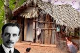 Rosto do Carlos Chagas em frente a uma cabana no interior