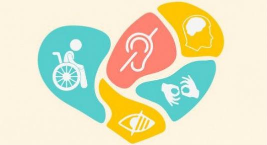 Coração com símbolos ligados a diversos tipos de deficiências